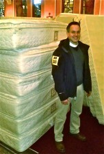 The Rev. Chris Ballard, GTS '12, with donated beds.